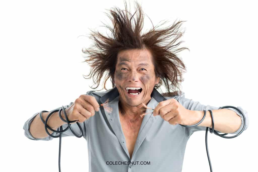 Person getting shocked by electrical wires.